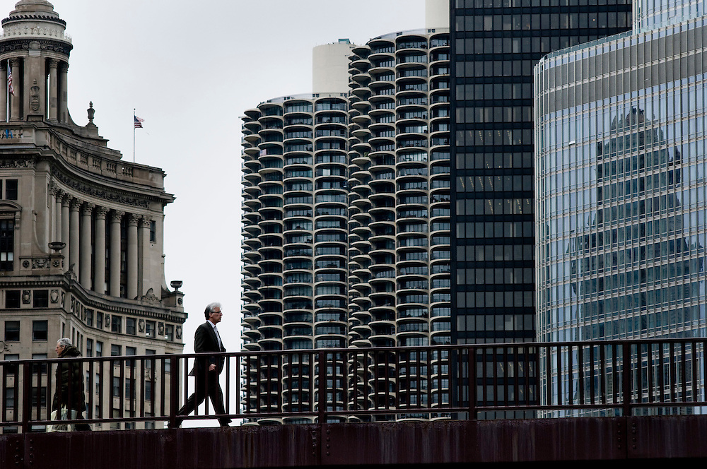 A man crossing the Chicago river at North Columbus Drive.<br /> <br /> Green Chicago..Photographer: Chris Maluszynski /MOMENT