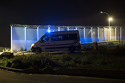 """Calais, Pas-de-Calais, France - 16.10.2016    <br />     <br /> Police forces near the camp.  """"Jungle"""" refugee camp on the outskirts of the French city of Calais. Many thousands of migrants and refugees are waiting in some cases for years in the port city in the hope of being able to cross the English Channel to Britain. French authorities announced that they will shortly evict the camp where currently up to up to 10,000 people live.<br /> <br /> Polizisten nahe des Camps. """"Jungle"""" Fluechtlingscamp am Rande der franzoesischen Stadt Calais. Viele tausend Migranten und Fluechtlinge harren teilweise seit Jahren in der Hafenstadt aus in der Hoffnung den Aermelkanal nach Großbritannien ueberqueren zu koennen. Die franzoesischen Behoerden kuendigten an, dass sie das Camp, indem derzeit bis zu bis zu 10.000 Menschen leben Kürze raeumen werden. <br /> <br /> Photo: Bjoern Kietzmann"""