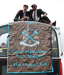 """Racegoers with a banner reading """"Congratulations Your Majesty"""" during derby day of the 2018 Investec Derby Festival at Epsom Downs Racecourse."""
