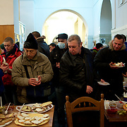 December 18, 2013 - Kiev, Ukraine: Pro-EU demonstrators get food donated inside the occupied City Hall.<br /> On the night of 21 November 2013, a wave of demonstrations and civil unrest began in Ukraine, when spontaneous protests erupted in the capital of Kiev as a response to the government's suspension of the preparations for signing an association and free trade agreement with the European Union. Anti-government protesters occupied Independence Square, also known as Maidan, demanding the resignation of President Viktor Yanukovych and accusing him of refusing the planned trade and political pact with the EU in favor of closer ties with Russia.<br /> After a days of demonstrations, an increasing number of people joined the protests. As a responses to a police crackdown on November 30, half a million people took the square. The protests are ongoing despite a heavy police presence in the city, regular sub-zero temperatures, and snow. (Paulo Nunes dos Santos)