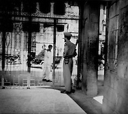 Armed Indian soldier stands watch at gate of Shah Hamden Mosque, Srinagar, Indian Adminstered Kashmir.  The Indian military occupation of the predominantly Muslim region has resulted in the death of over 80,000 Kashmiris.