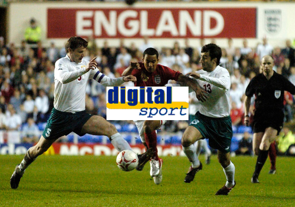 Photo: Richard Lane.<br />England 'B' v Belarus. International Friendly. 25/05/2006.<br />England's Theo Walcott is brought down by Aliaksandr Shahoika (R) and Sergei Shtanyuk.