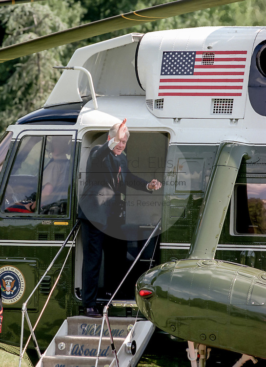 US President Clinton waves as he boards Marine One helicopter on the South Lawn of the White House August 19, 1999 in Washington, DC. The Clinton's are traveling to Martha's Vineyard for a vacation.