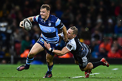 27th April 2019 , Principality Stadium , Cardiff, Wales ; Guinness pro 14's, Round 21, Cardiff Blues Vs Ospreys ; Jarrod Evans of Cardiff Blues is tackled by Hanno Dirksen of Ospreys<br /> <br /> Credit :  Craig Thomas/Replay Images