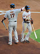 June 14 2011; Phoenix, AZ, USA; San Francisco Giants base runner Andres Torres (56) is congratulated by teammate Aubrey Huff (17) after scoring during the first inning against the Arizona Diamondbacks at Chase Field. Mandatory Credit: Jennifer Stewart-US PRESSWIRE..
