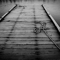 A frost covered dock with frozen ropes at Lost Lagoon, Vancouver Canada.