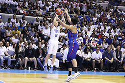 November 27, 2017 - Quezon City, NCR, Philippines - Kai-Yan Lee (66) of Chinese Taipei tries to shoot the ball over Junemar Fajardo (15) of the Philippines..Gilas Pilipinas defeated the visiting Chinese Taipei team 90-83 to complete a sweep of their first two assignments in the FIBA 2019 World Cup qualifiers. (Credit Image: © Dennis Jerome S. Acosta/Pacific Press via ZUMA Wire)