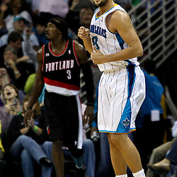 March 30, 2011; New Orleans, LA, USA; New Orleans Hornets shooting guard Marco Belinelli (8) reacts after scoring on a three point basket during the third quarter against the Portland Trail Blazers at the New Orleans Arena. The Hornets defeated the Trail Blazers 95-91.   Mandatory Credit: Derick E. Hingle