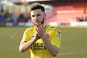 Fleetwood Town defender Lewis Coyle,  (2) on loan from Leeds United, applauds the fans after the win in the EFL Sky Bet League 1 match between Accrington Stanley and Fleetwood Town at the Fraser Eagle Stadium, Accrington, England on 30 March 2019.