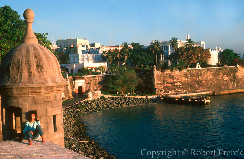 PUERTO RICO, SAN JUAN World Heritage Site; city walls and San Juan Gate on the bay, with La Fortaleza mansion above the walls (center)