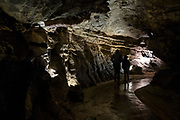 An adult and child walk through Dan yr Ogof Cave in the National Showcaves Centre for Wales, Abercrave, Swansea, Wales, UK.  It is a 17-kilometer cave system in South Wales.  (photo by Andrew Aitchison / In pictures via Getty Images)