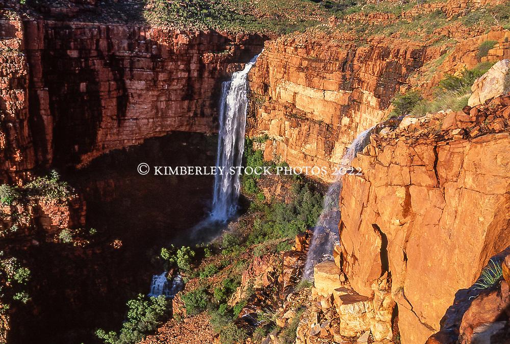 Water cascades over Fitzroy Bluff in the Kimberley wet season.