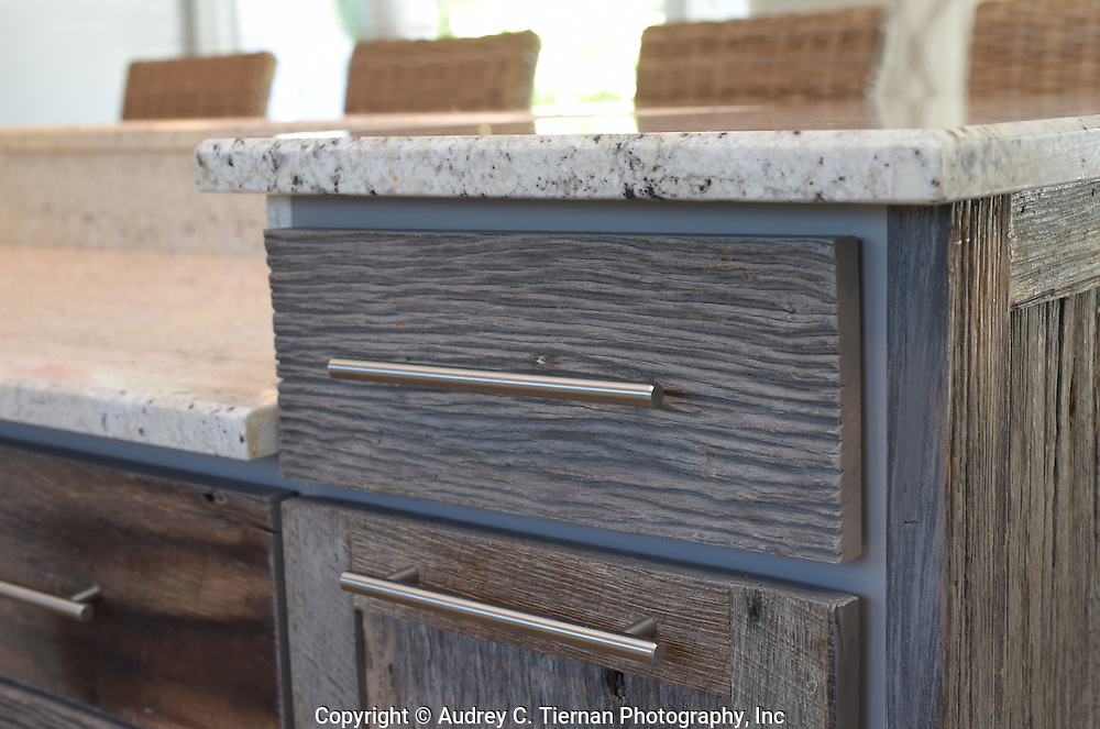 Hampton Bays, NY,  July 27, 2016: ---  A detail of reclaimed barn wood kitchen cabinets created by Stepman Construction.    © Audrey C. Tiernan