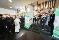 """21 June 2018, Geneva, Switzerland: On 21 June 2018, the World Council of Churches receives a visit from Pope Francis of the Roman Catholic Church. Held under the theme of """"Ecumenical Pilgrimage - Walking, Praying and Working Together"""", the landmark visit is a centrepiece of the ecumenical commemoration of the WCC's 70th anniversary. The visit is only the third by a pope, and the first time that such an occasion was dedicated to visiting the WCC. Here, Pope Francis farewelled by WCC staff and friends."""