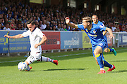 AFC Wimbledon midfielder Tom Beere (16) and Bolton Wanderers striker Zack Clough (10) during the EFL Sky Bet League 1 match between AFC Wimbledon and Bolton Wanderers at the Cherry Red Records Stadium, Kingston, England on 13 August 2016. Photo by Stuart Butcher.