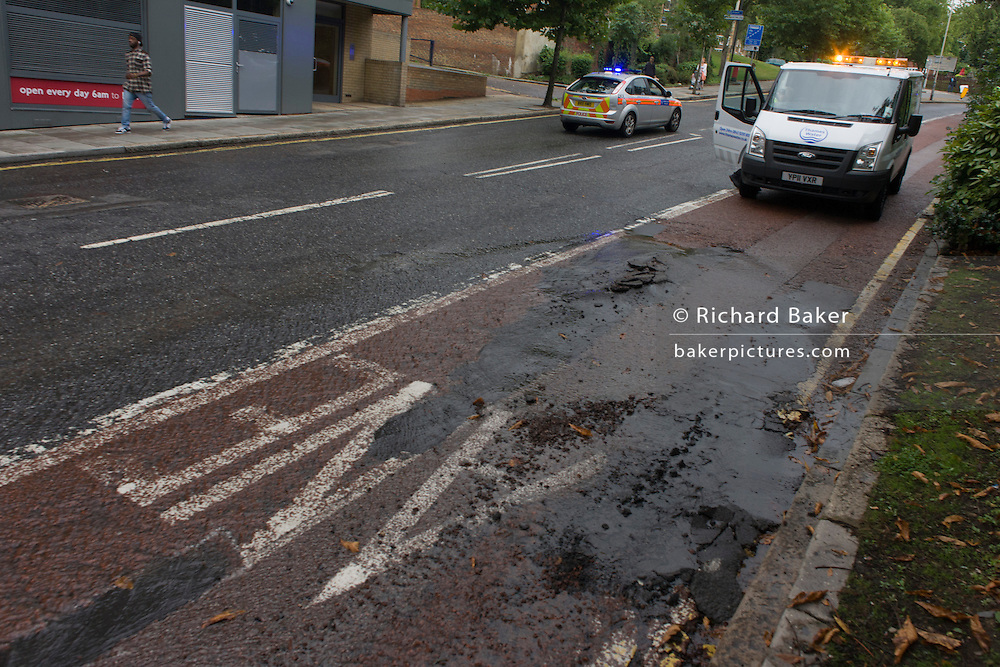 A cracked road surface, weeks after the disastrous flooding in nearby Herne Hill, Denmark Hill was closed in both directions due to another burst water main in multiple locations across the road (A215) between the junctions of Champion Hill and Champion Park in south London. Water was seen running towards Kings College Hospital, 200 yards downhill and Denmark Hill is a major thoroughfare for the hospital's A+E.