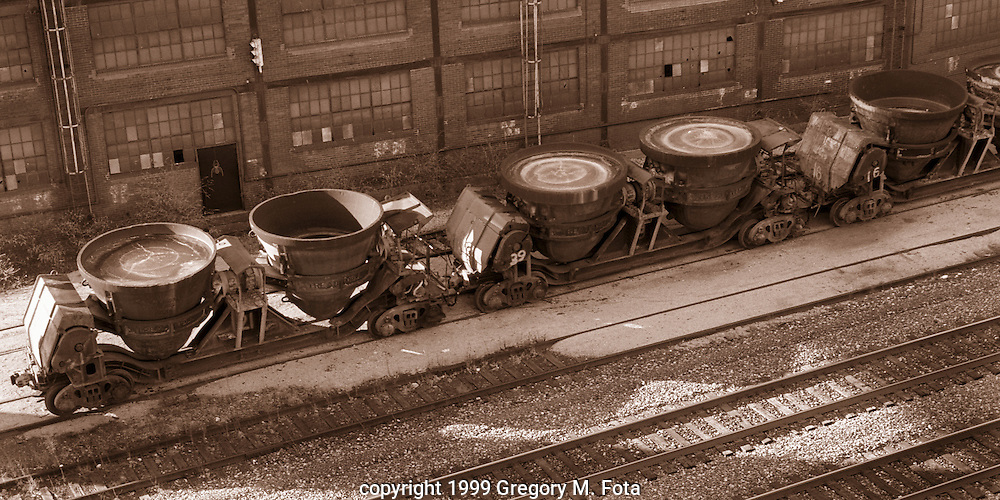 TREADWELL TRAIN-Treadwell slag cars sit on tracks at Bethlehem Steel,Bethlehem,PA. The pots collected hot slag from the blast furnaces during a pour of molten iron. 02/27/1999..Duotone..