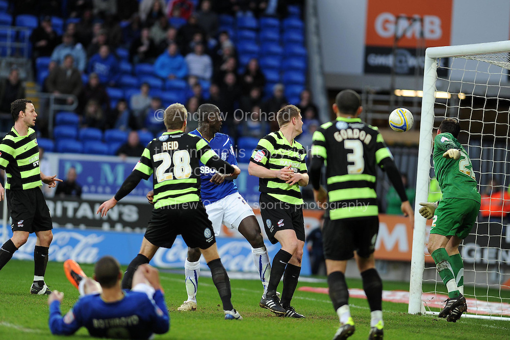 Cardiff city's Seyi Olofinjana (in centre) rises to score the match winning goal with a close range header. NPower championship. Cardiff city v Scunthorpe Utd at the Cardiff city stadium in Cardiff on Sat 12th Feb 2011. pic by Andrew Orchard, Andrew Orchard sports photography,