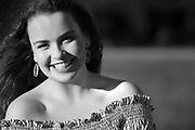 Black and white graduation portrait of senior girl.