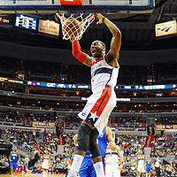 01 November 2013:   Washington Wizards point guard John Wall (2) dunks the ball in action against the Philadelphia 76ers as the Philadelphia 76ers defeated the Washington Wizards, 109-102 in the Wizards home opener at the Verizon Center in Washington, D.C.