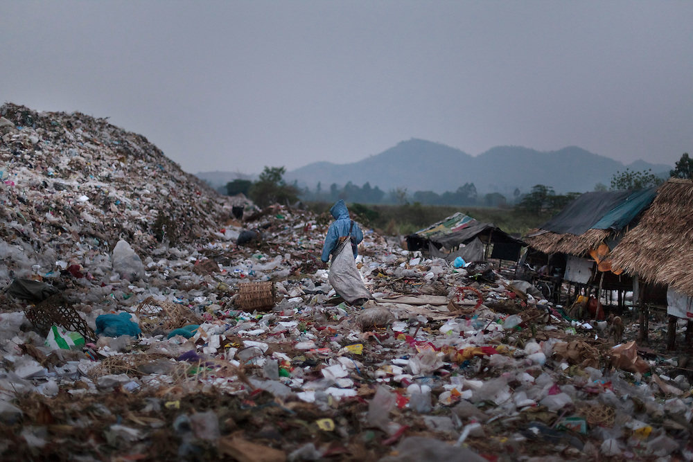 A refugee child from Myanmar walking alone through a rubbish dump in Mae Sot on Sunday, 25, 2012. With April 1 elections coming soon Myanmar has suffered conflict between the repressive ruling military regime, political opponents and ethnic groups, resulting in the displacement of over 400.000 Burmese according to UNHCR, around 140.000 of them in Thailand.