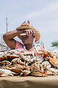 Ruth Schoolfield, pauses to wipe her brow during the annual crab picking competition during Labor Day Festivities in Crisfield, Md. Crisfield depends on tourists during Labor Day to help their economy, but turnout keeps declining year after year.