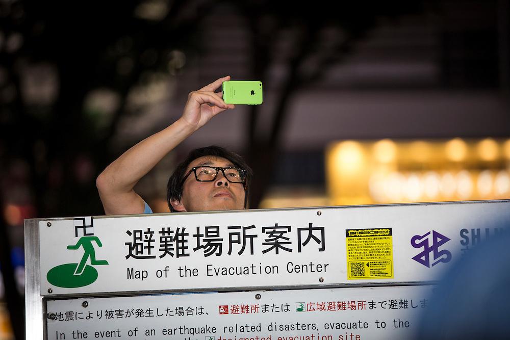 TOKYO, JAPAN - JULY 20 : Supporter of Mac Akasaka take photo documentation with iPhone during the campaign speech rally for the July 31 Tokyo gubernatorial election in Kabukicho,  Shinjuku, Tokyo, Japan on Wednesday, July 20, 2016.   (Photo: Richard Atrero de Guzman/NUR Photo)