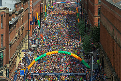 © Licensed to London News Pictures . 20/05/2018 . Manchester , UK . Participants form up on Portland Street in Manchester City Centre for the start of the 10k race in the Great Manchester Run . A minute of silence is held ahead of the start of the race to mark the first anniversary of the Manchester Arena bombing , which killed 22 and seriously injured dozens more , at an Ariana Grande concert on 22nd May 2017 . Photo credit : Joel Goodman/LNP