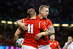 Wales Winger Hallam Amos celebrates scoring a try with replacement Dominic Day  - Mandatory byline: Rogan Thomson/JMP - 07966 386802 - 20/09/2015 - RUGBY UNION - Millennium Stadium - Cardiff, Wales - Wales v Uruguay - Rugby World Cup 2015 Pool A.