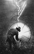 Near Othello, a farmer irrigates a field with water that has traveled hundreds of miles from the Columbia River, helping arid land sustain a $ multi billion-a-year agriculture economy. (Tom Reese / The Seattle Times, 1991)