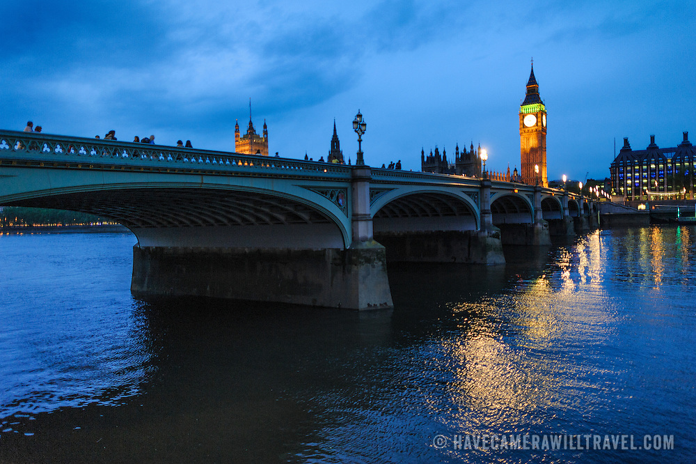Westminster Bridge in the foreground with Big Ben and the Palace of Westminster (Houses of Parliament) in the background) at dusk.