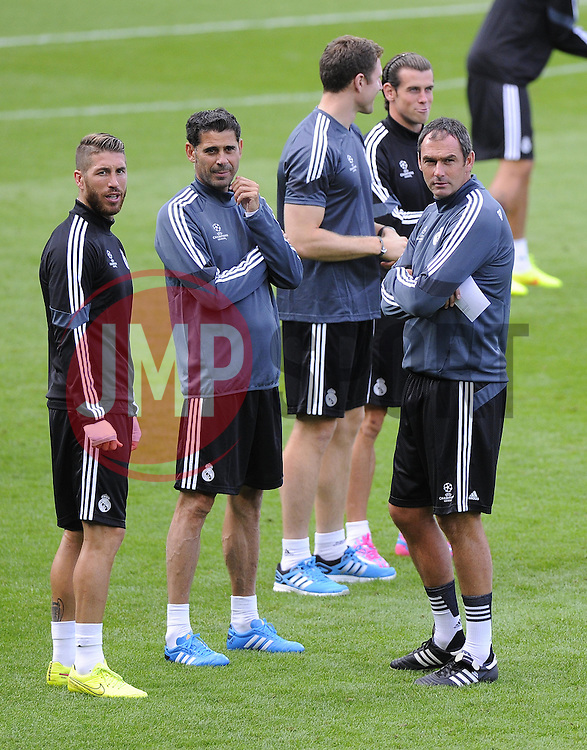 Real Madrid's Sergio Ramos, Real Madrid Assistant Coach, Fernando Hierro and Real Madrid Assistant Coach, Paul Clement talk before training  - Photo mandatory by-line: Joe Meredith/JMP - Mobile: 07966 386802 11/08/2014 - SPORT - FOOTBALL - Cardiff - Cardiff City Stadium - Real Madrid v Sevilla - UEFA Super Cup - Press Conference and Open Training session