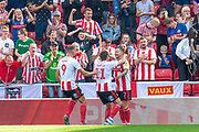Chris Maguire (#7) of Sunderland AFC celebrates with Charlie Wyke (#9) of Sunderland AFC and Lynden Gooch (#11) of Sunderland AFC after scoring the opening goal during the EFL Sky Bet League 1 match between Sunderland and AFC Wimbledon at the Stadium Of Light, Sunderland, England on 24 August 2019.
