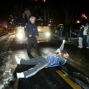 A Seattle Seahawks fan, desperately clutching to the 2006 season, lays in front of the Seahawks team bus as the Seattle Seahawks leave Boeing Field after returning from Chicago on Sunday January 14, 2007 in Seattle.  Police moved the fan.  Joshua Trujillo / Seattle Post-Intelligencer.