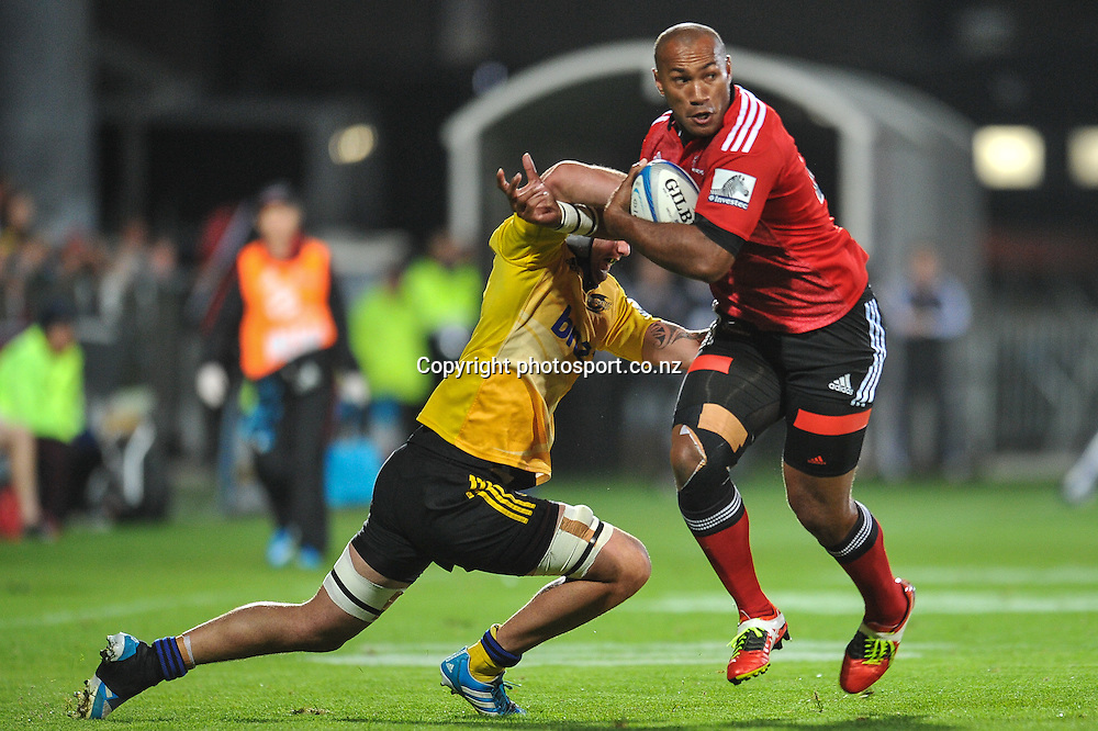 Nemani Nadolo of the Crusaders fends off Blade Thomson of the Hurricanes in the Super Rugby game, Crusaders v Hurricanes, 28 March 2014. Photo:John Davidson/photosport.co.nz