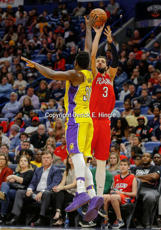 Feb 14, 2018; New Orleans, LA, USA; New Orleans Pelicans forward Nikola Mirotic (3) shoots over Los Angeles Lakers forward Julius Randle (30) during the second half at the Smoothie King Center. The Pelicans defeated the Lakers 139-117. Mandatory Credit: Derick E. Hingle-USA TODAY Sports