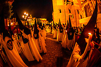 Hooded Penitents (Nazarenos) in the procession of the Brotherhood (Hermandad) San Benito, Holy Week (Semana Santa), Seville, Andalusia, Spain.