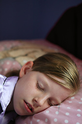 Girl in bed sleeping,