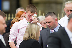 © Licensed to London News Pictures. 19/07/2012. Oldham , UK . Mourners at the funeral of 2 year old Jamie Heaton , who was killed in a blast in his home on 26/06/2012 . Photo credit : Joel Goodman/LNP