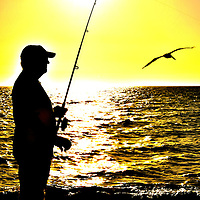 Man Fishing During Gulf Coast Sunset in Naples, Florida<br />