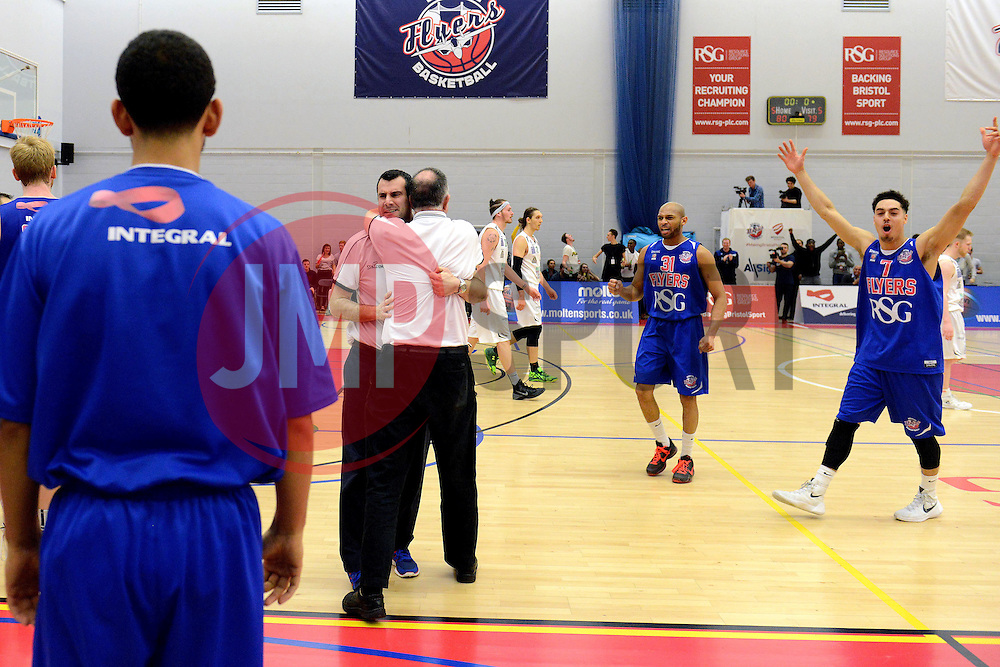 Bristol Flyers coach, Andreas Kapoulas and Bristol Flyers celebrate on the final whistle after beating Plymouth Raiders - Mandatory byline: Dougie Allward/JMP - 11/12/2015 - Basketball - SGS Wise Campus - Bristol, England - Bristol Flyers v Plymouth Raiders - British Basketball League
