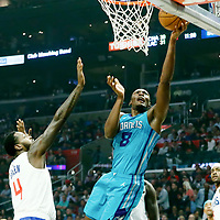 LOS ANGELES, CA - OCT 28: Bismack Biyombo (8) of the Charlotte Hornets shoots the ball during a game on October 28, 2019 at the Staples Center, in Los Angeles, California.