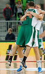 Dusan Djordjevic and  Edo Muric of Krka celebrate after the basketball match between KK Union Olimpija and KK Krka in 4th Round of Final of Slovenian Basketball National Championship, on June 9, 2011 in Arena Stozice, Ljubljana, Slovenia. Krka defeated Union Olimpija 63-61. (Photo By Vid Ponikvar / Sportida.com)