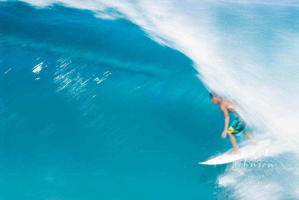 Slow shutter blur efffect of Surfing at Backdoor Pipeline, North Shore, Oahu, Hawaii