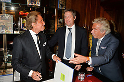 Left to right, VALENTINO GARAVANI, HUGH GRANT and GIANCARLO GIAMMETTIat a party to celebrate the launch of the Maison Assouline Flagship Store at 196a Piccadilly, London on 28th October 2014.  During the evening Valentino signed copies of his new book - At The Emperor's Table.