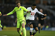 Derby County defender Cyrus Christie and Brighton striker (on loan from Manchester United), James Wilson (21) battle for possession during the Sky Bet Championship match between Derby County and Brighton and Hove Albion at the iPro Stadium, Derby, England on 12 December 2015.