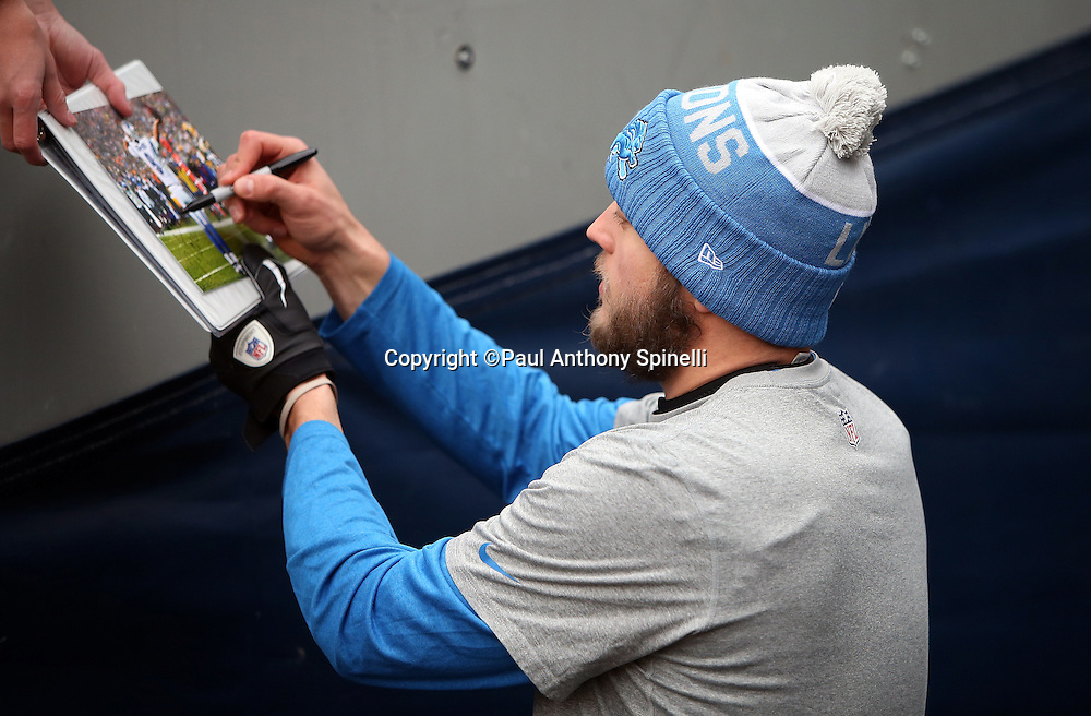 Detroit Lions quarterback Matthew Stafford (9) signs an autograph before the NFL week 17 regular season football game against the Chicago Bears on Sunday, Jan. 3, 2016 in Chicago. The Lions won the game 24-20. (©Paul Anthony Spinelli)