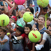 Young fans jockey for position to get Serena Williams' autograph after the Sloane Stephens, USA, against Serena Williams, USA, match during the Women's Singles competition at the US Open. Flushing. New York, USA. 1st September 2013. Photo Tim Clayton