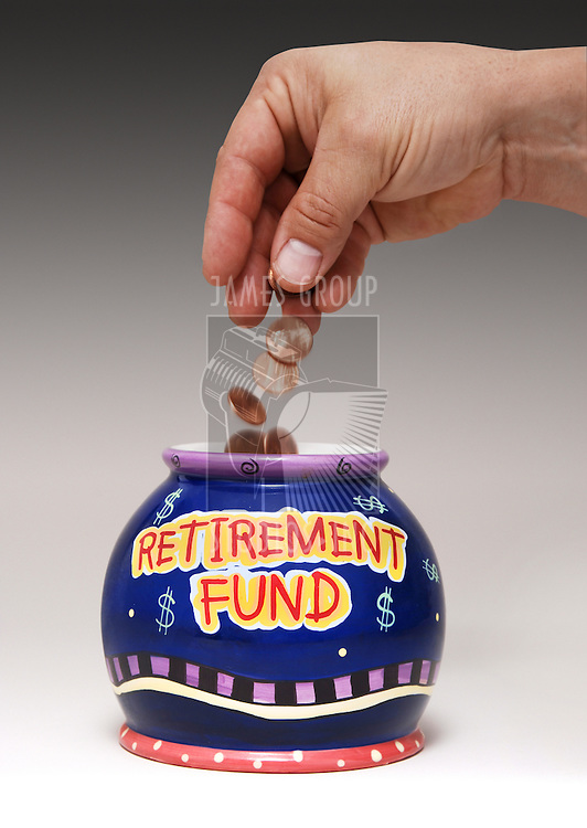 "hand dropping pennies into a jar labeled ""Retirement Fund"""