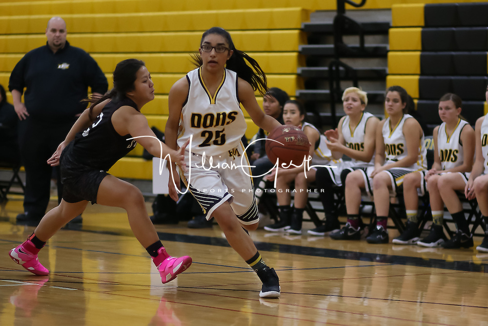 (Photograph by Bill Gerth for SVCN) Del Mar #25 Vanessa Vindell drives to the basket vs Sobarto in a pre season girls varsity basketball game at Del Mar High School, San Jose CA on 11/29/16.  (Sobarto 47 Del Mar 40)